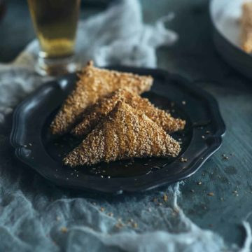 greek cheese pies covered in sesame seeds