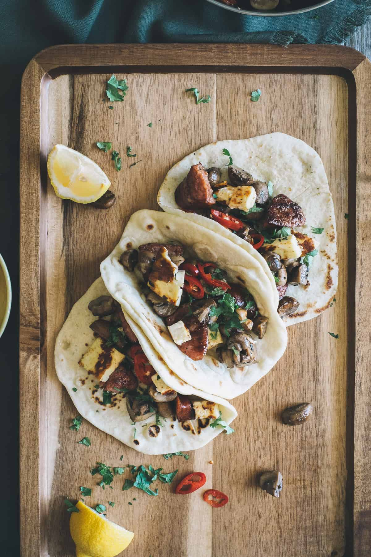 mushroom chorizo and halloumi tacos served on a board