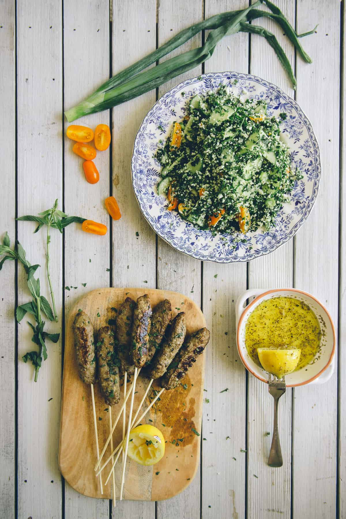 beef kofta with grain free tabouli served on a table