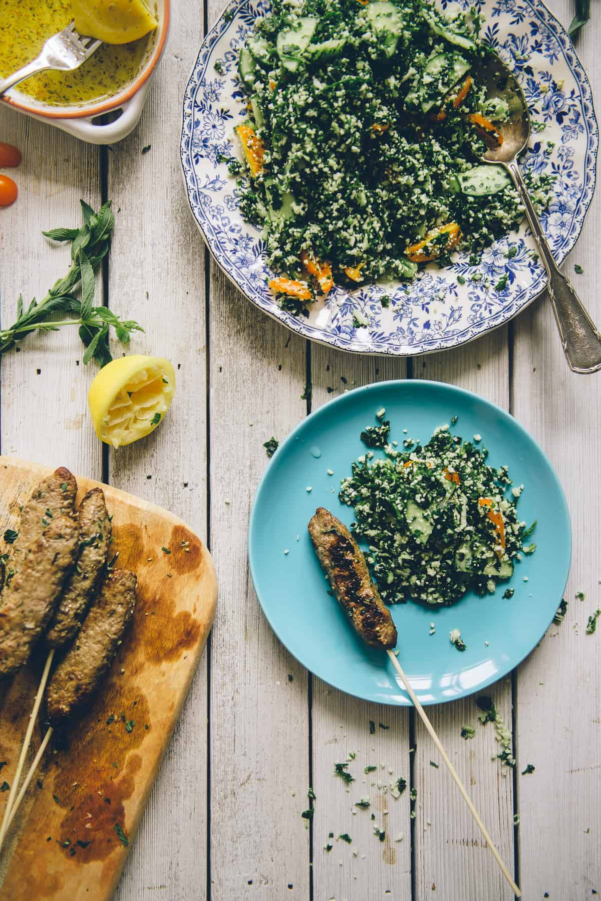 Middle Eastern beef kofta served with a grain free tabouli on a table