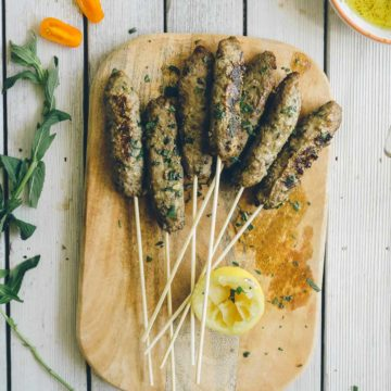 beef kofta served on a chopping board