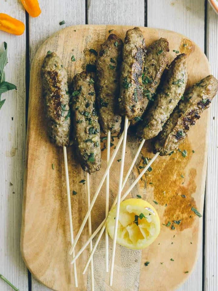 beef kofta served on a chopping board