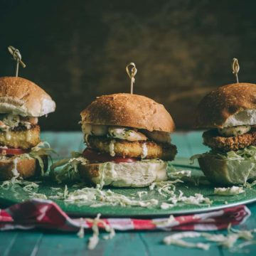 three burgers made with halloumi cheese on a plate