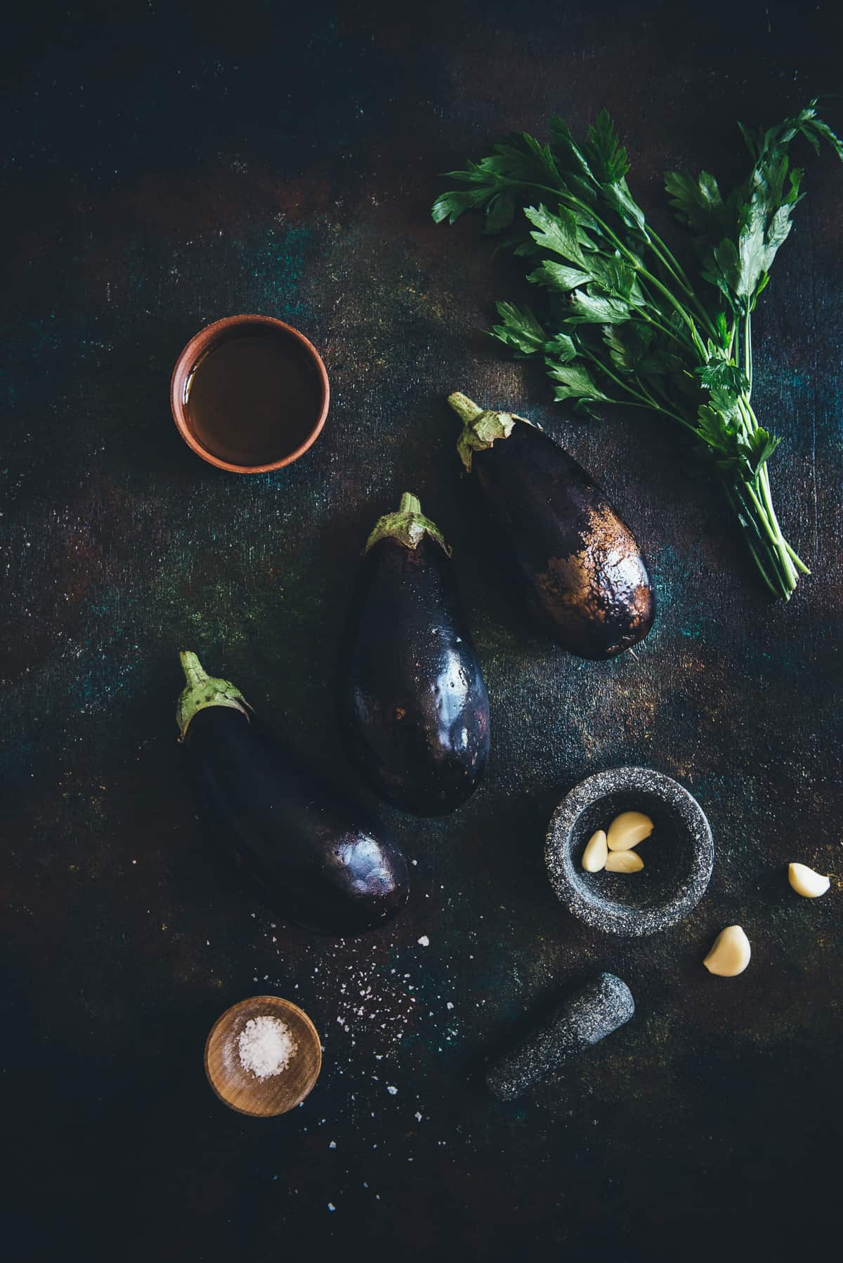 eggplants and herbs on a table