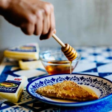 honey being drizzled over fried cheese