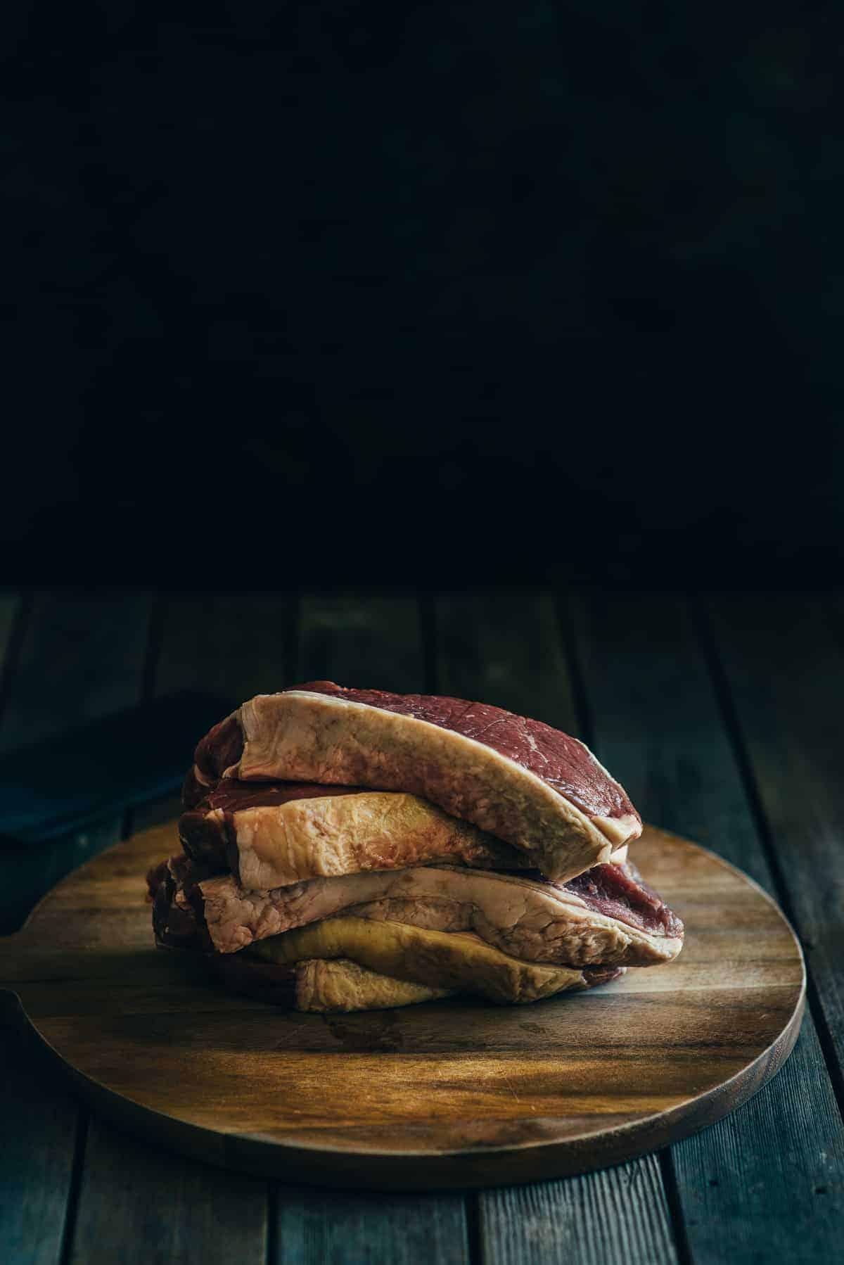 steaks on a chopping board
