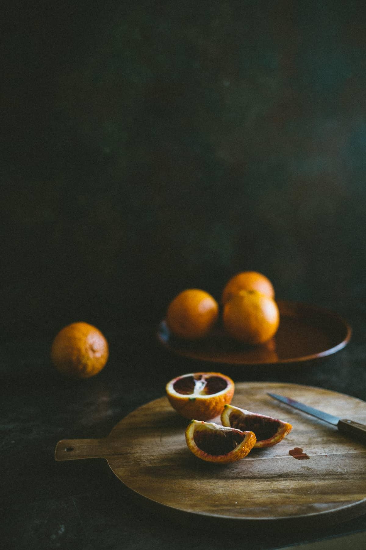 sliced blood oranges on a chopping board