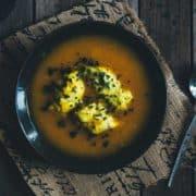 a bowl of soup with dumplings