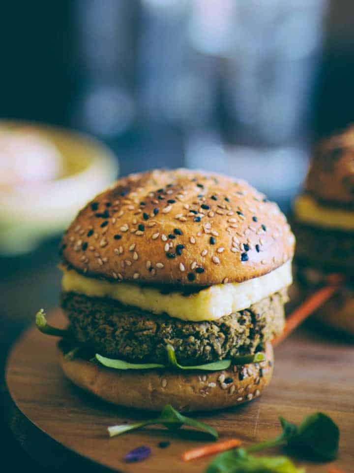 a burger made with chickpeas and quinoa and topped with halloumi cheese
