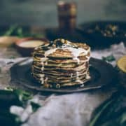 Middle Eastern inspired pancakes served on a plate drizzled with tahini