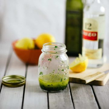 a salad dressing inside an old jam jar