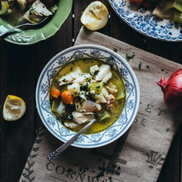 fish and vegetable soup served in a bowl