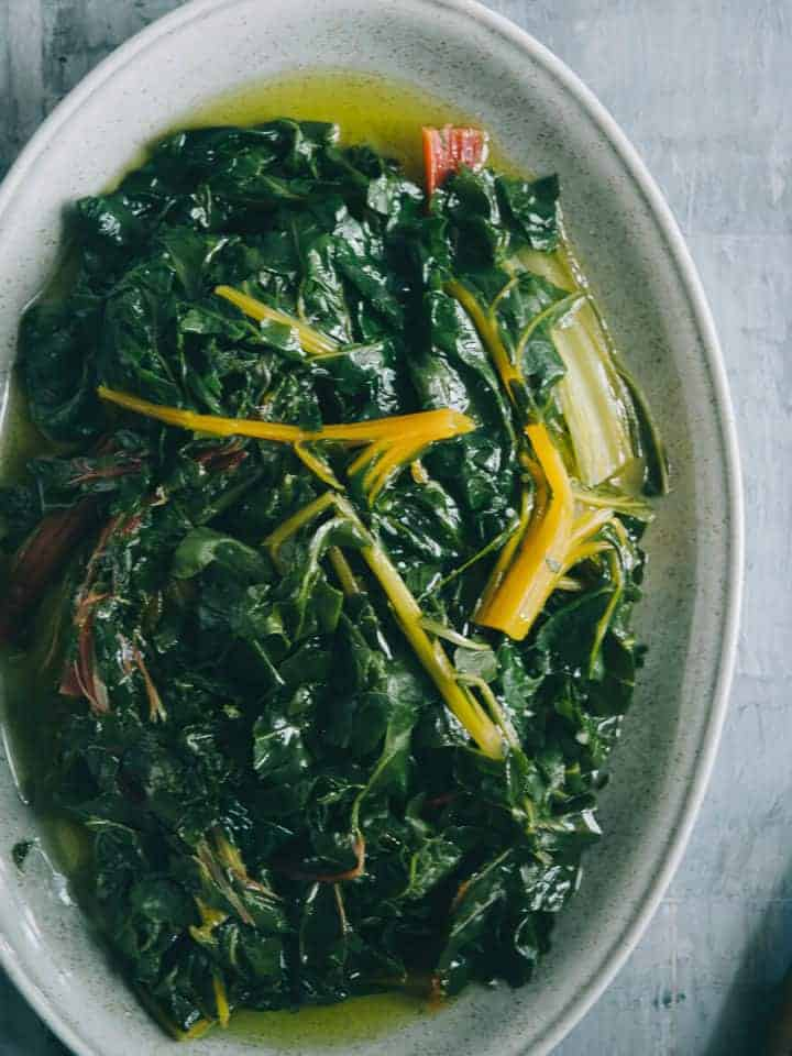 blanched greens served on a plate