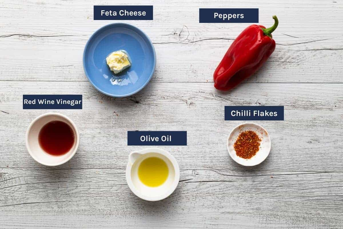 ingredients to make htipiti - a Greek red pepper and feta dip - laid out on a table