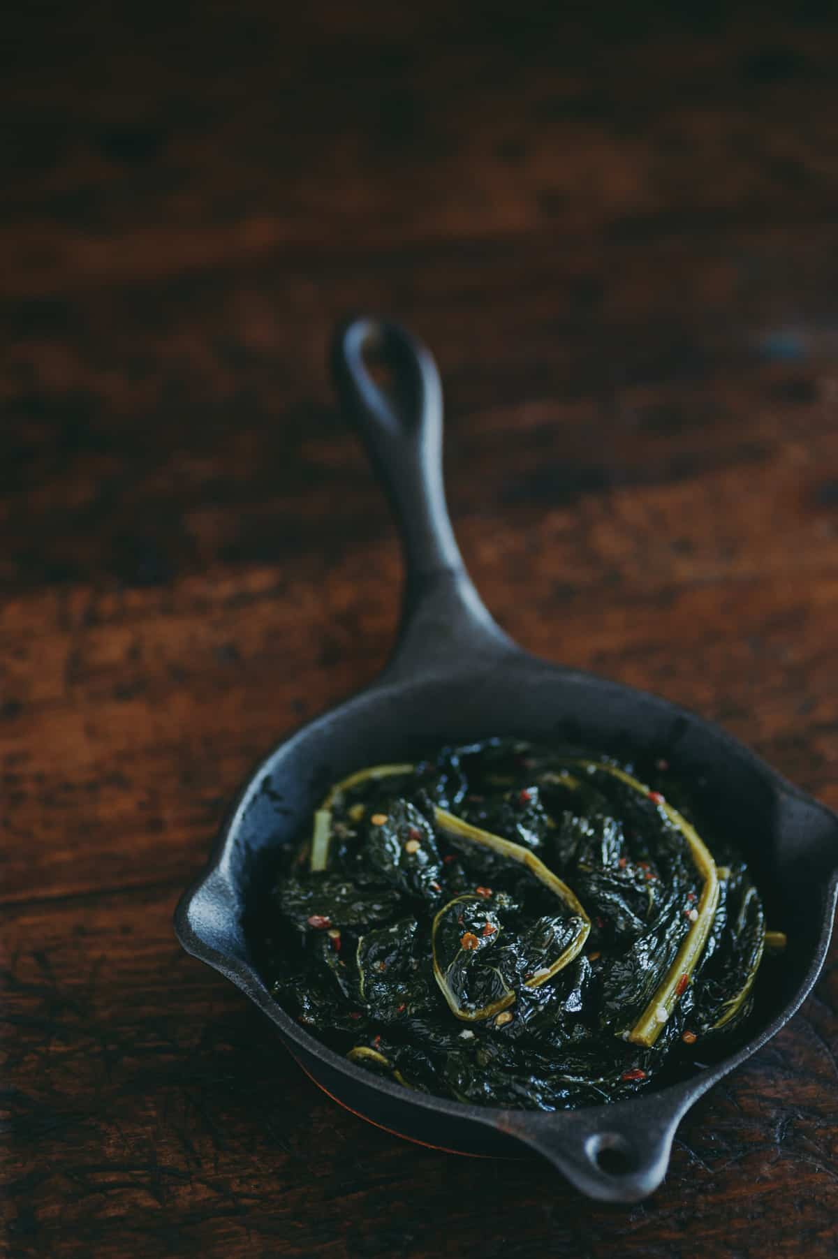 braised cavolo nero in a cast iron pan