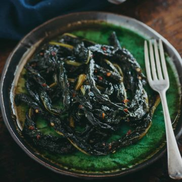 braised cavolo nero on a green plate