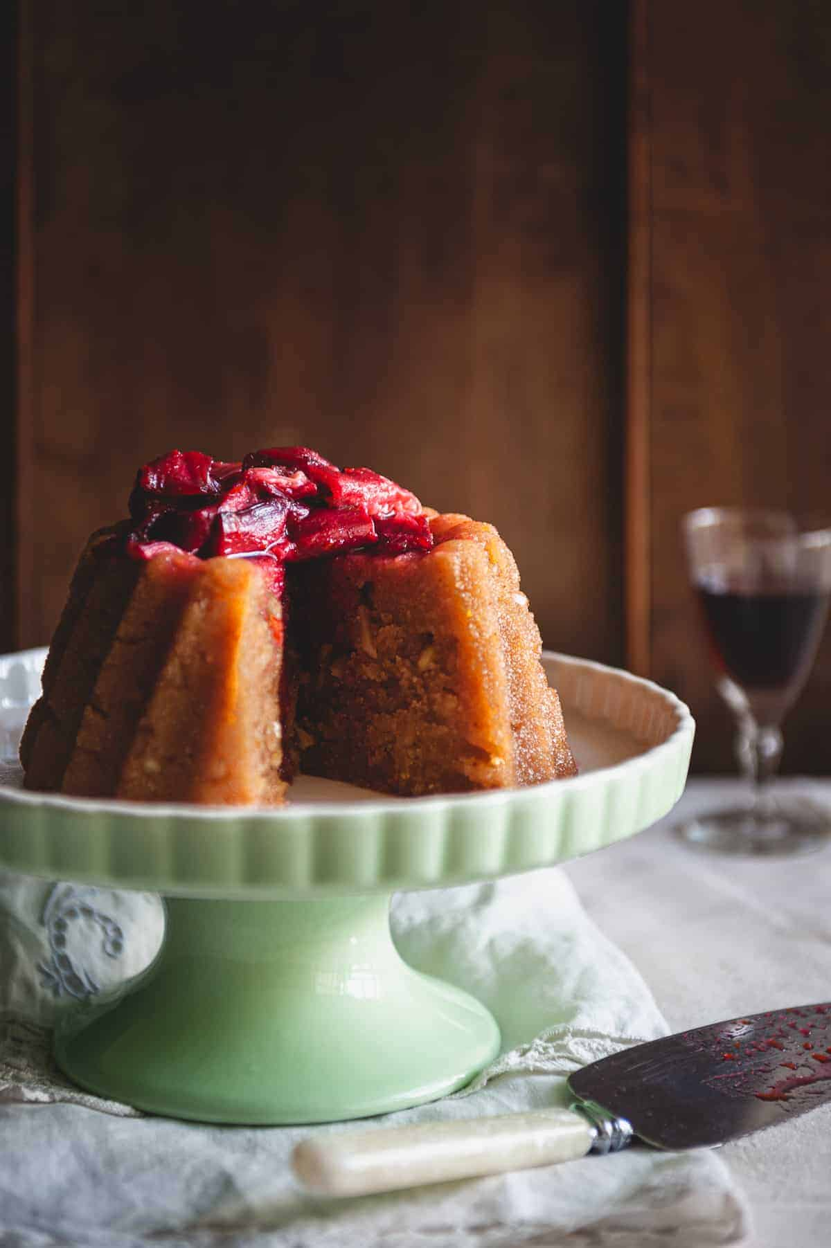 a Greek dessert known as halva on a cake stand served with a rhubarb compote