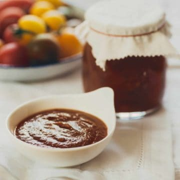a small ramekin filled with homemade tomato ketchup on a table