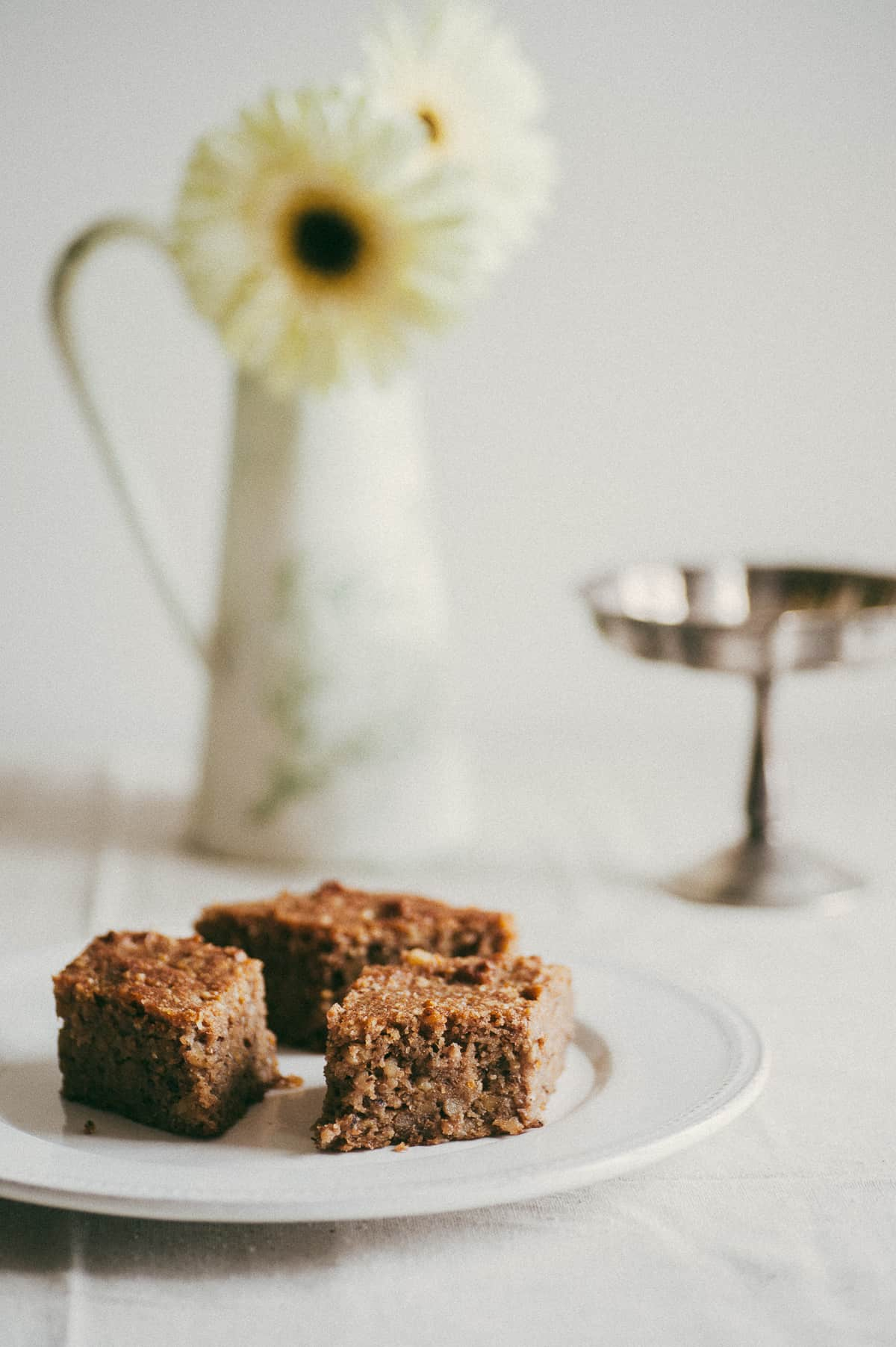 three pieces of Greek walnut cake served on white plate