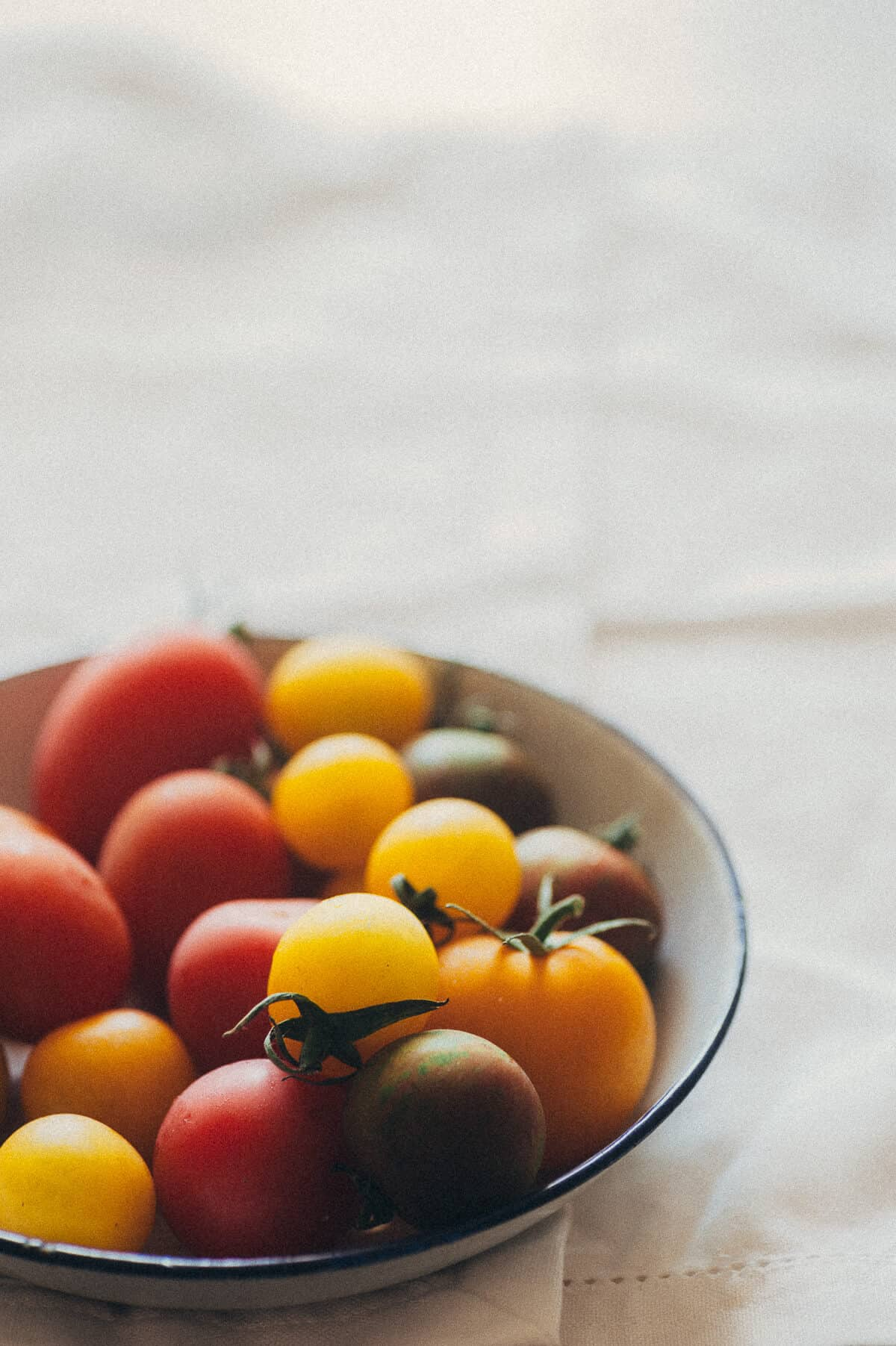 small coloured tomatoes on a plate