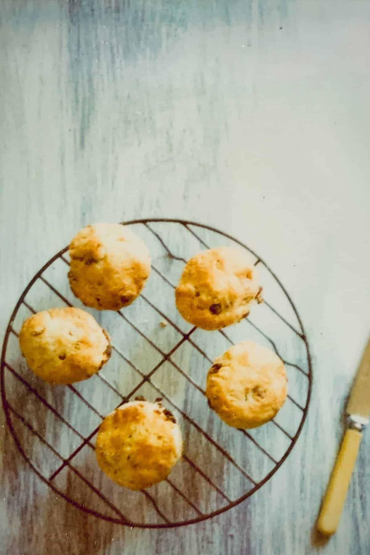 five scones on a cooling rack