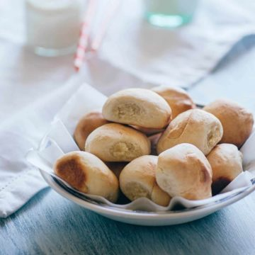a bowl filled with pan de leche - a sweet bread made with milk