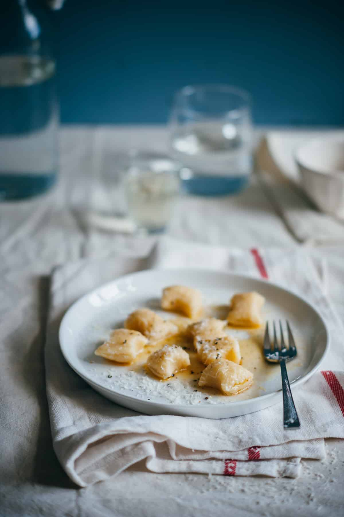 gnocchi made from ricotta served on a white plate
