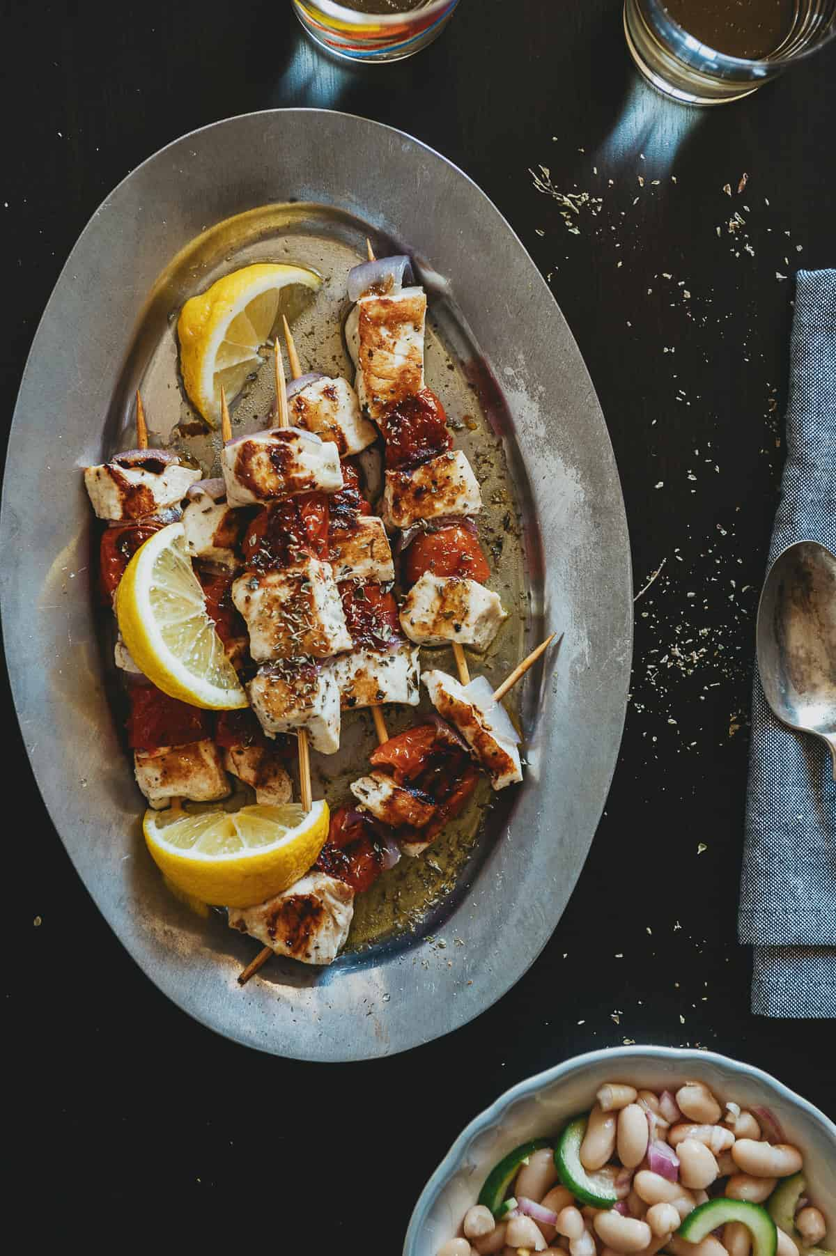 a silver platter with 6 serves of freshly grilled swordfish souvlaki