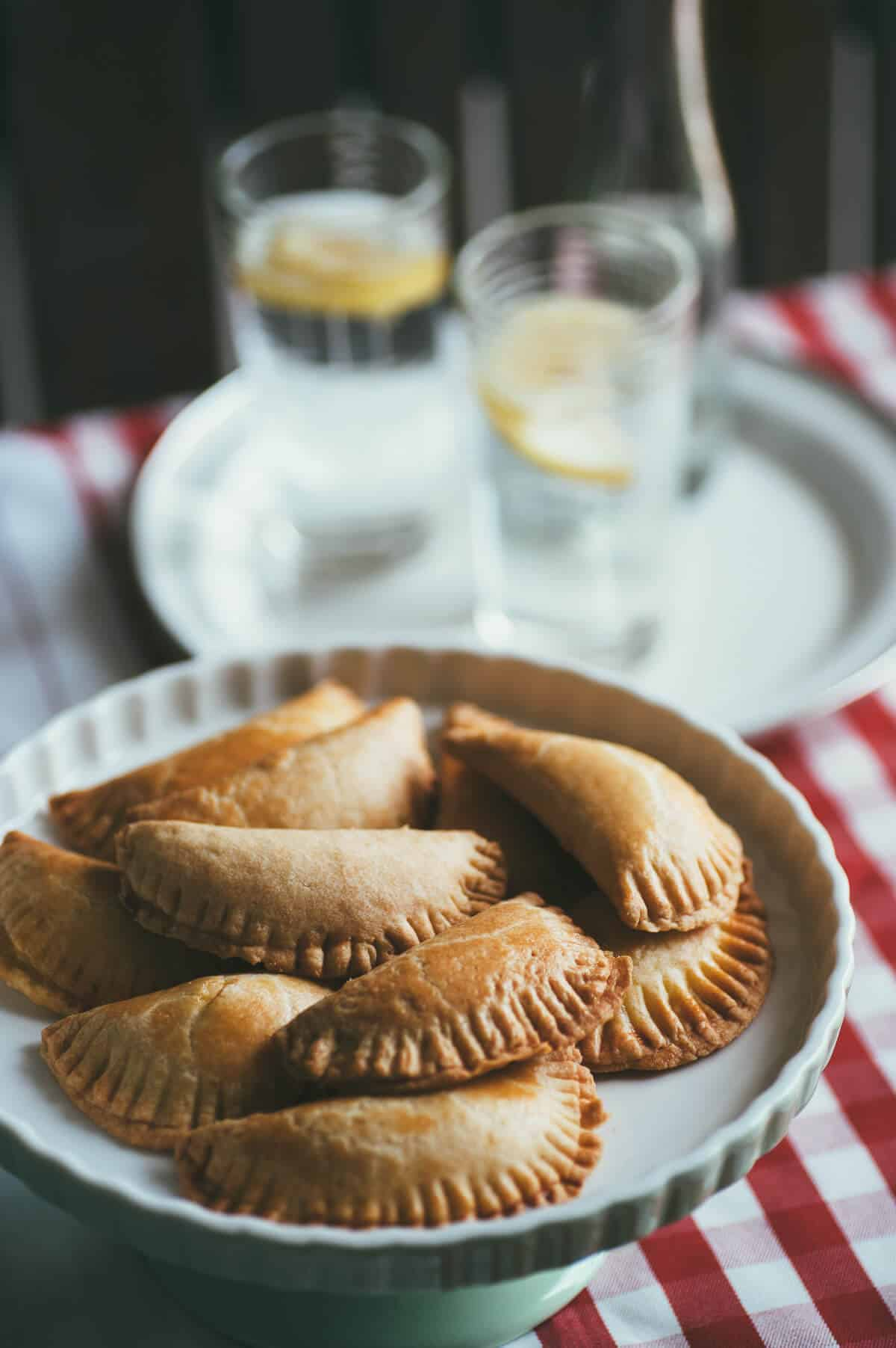 crescent shaped mini pies presented on a large pie stand
