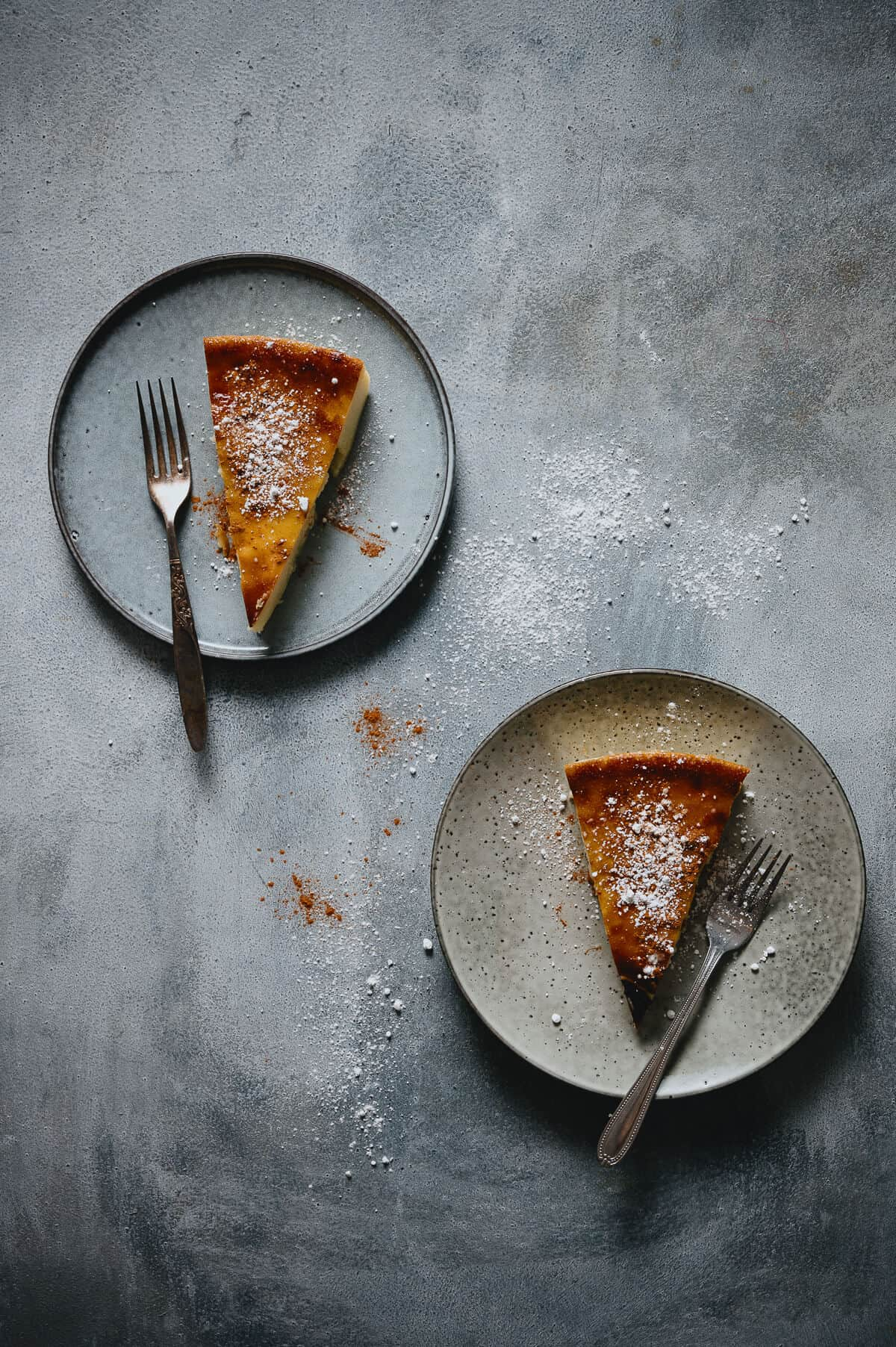 2 plates each with a serve of galatopita - greek milk pie placed on a great table