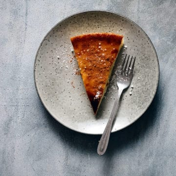 a slice of pie served on a grey plate