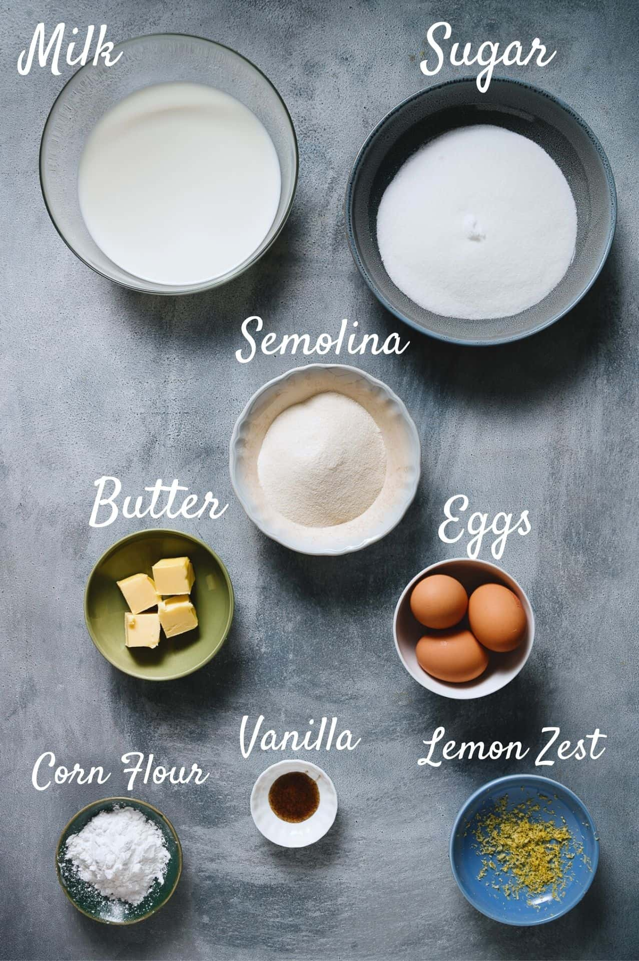 ingredients required to make  a Greek milk pie all laid out on a grey table
