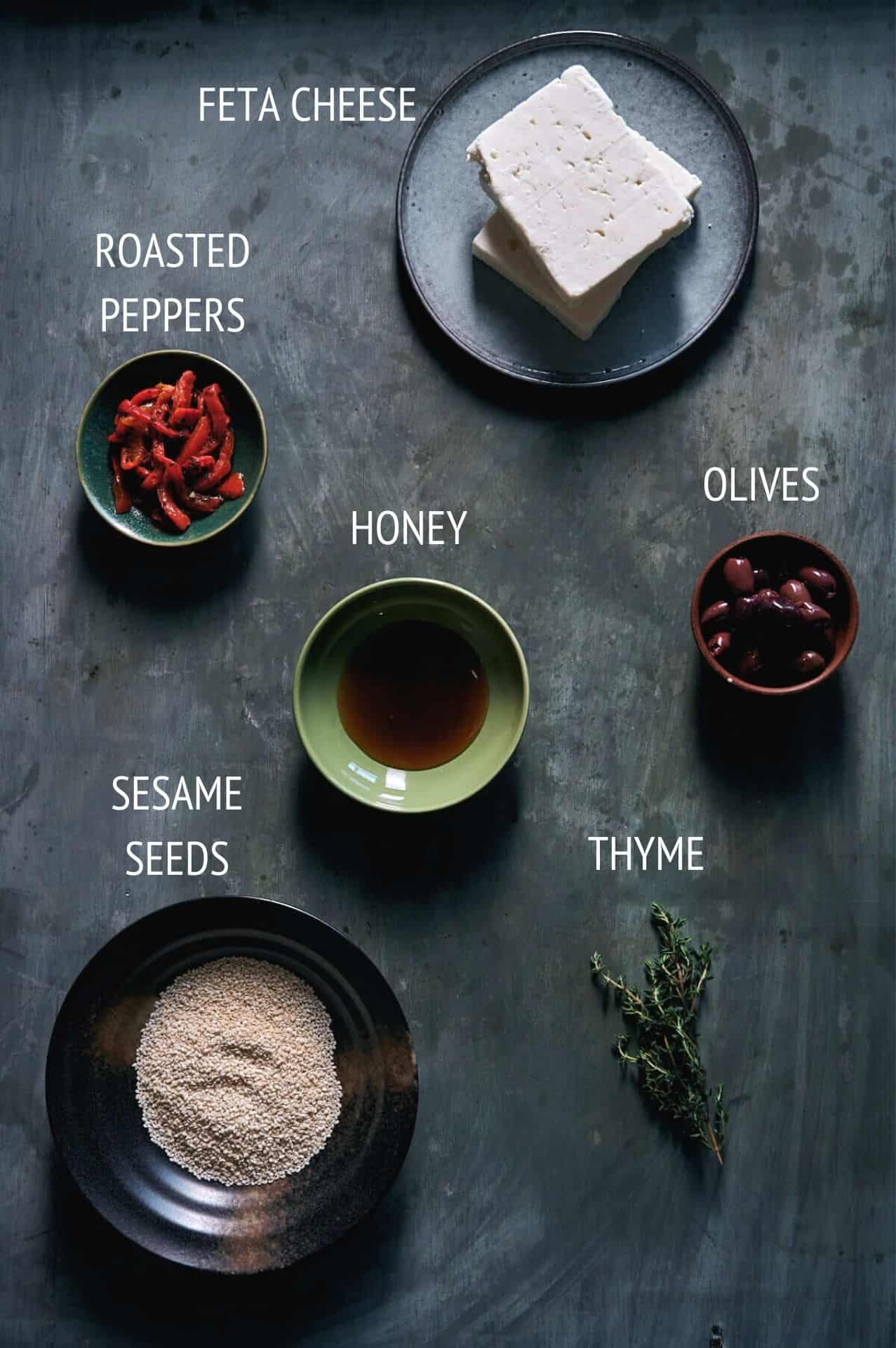 a table with all the ingredients required to make baked feta