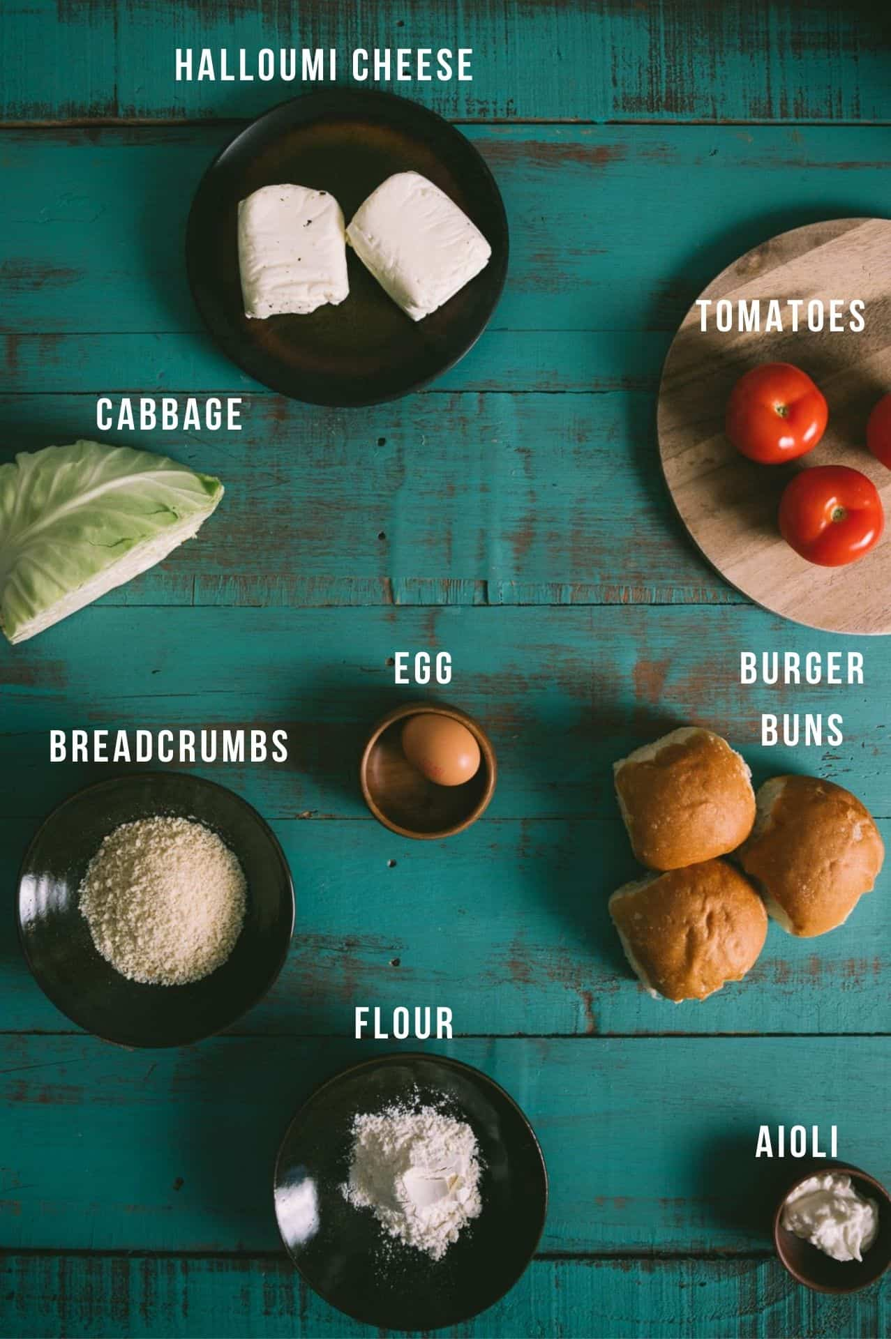 all the ingredients for a halloumi burger on a table