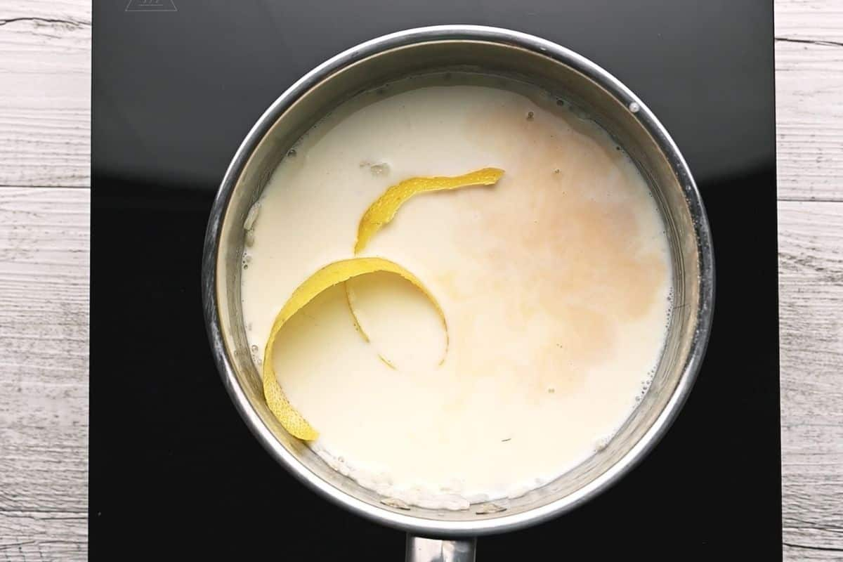 milk in a pot with lemon peel
