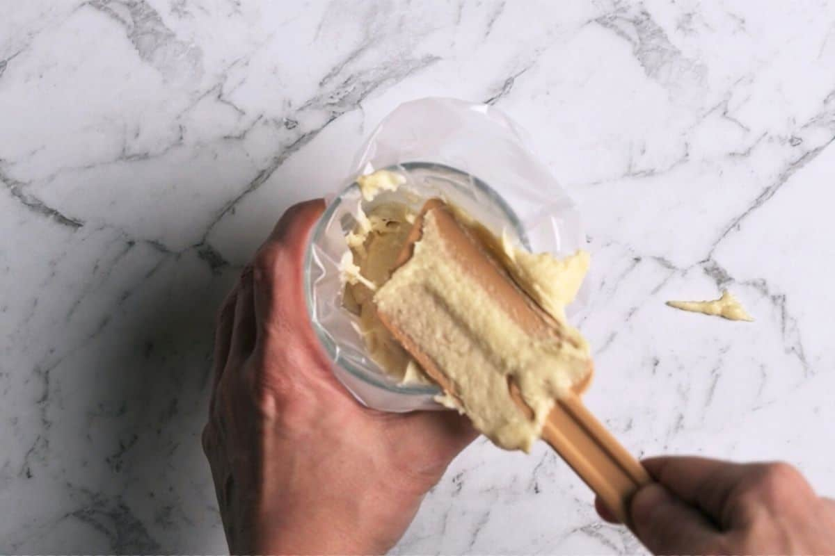 spooning batter into a piping bag