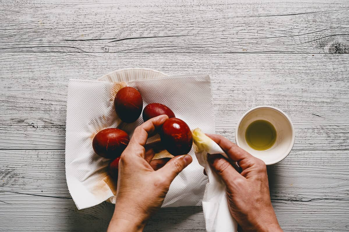 polishing dyed red eggs with olive oil