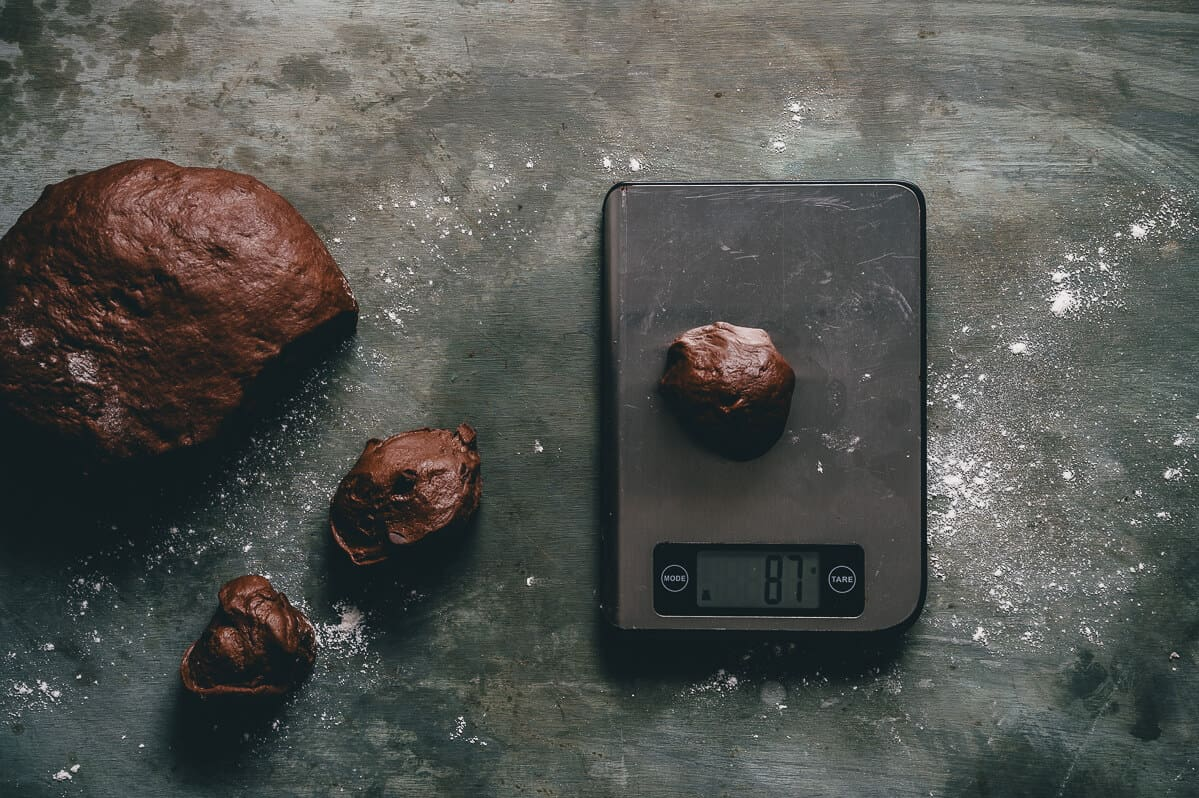 chocolate dough being weighed on kitchen scales