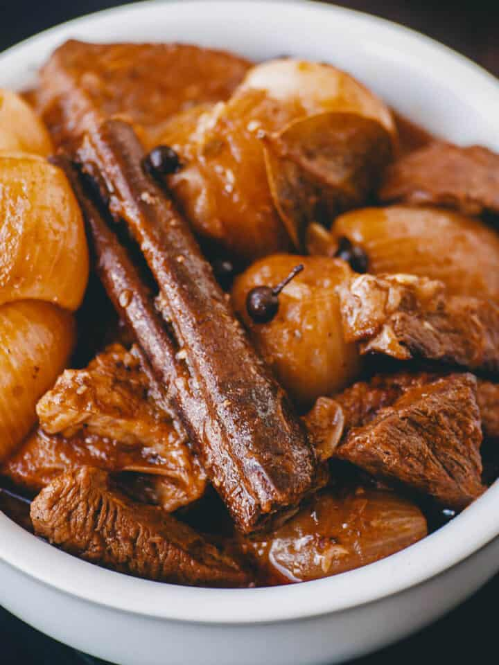 close up of stewed beef with onions and cinnamon