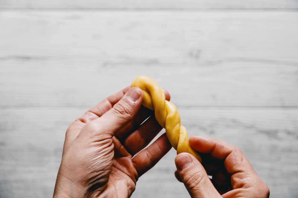 twisting dough to form traditional Easter cookies
