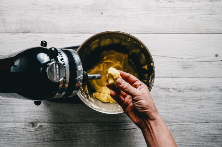 a hand feeling cookie dough