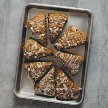 baked pumpkin scones on a baking tray.